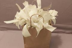 Gift Bag Scrunchie in Bare Bone sits atop a paper bag to hide the goodies inside!